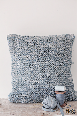Knitted denim cushion